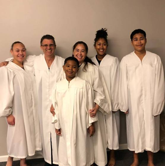 Pastor James with all five baptism candidates: (L to R): Ella, James, Taino, Yvonne, Alanis, and Robert