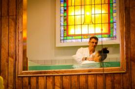 Pastor James baptizing